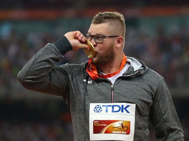 Gold medalist Pawel Fajdek of Poland poses on the podium during the medal ceremony for the Men's Hammer final during day two of the 15th IAAF World Athletics Championships Beijing 2015 at Beijing National Stadium on August 23, 2015