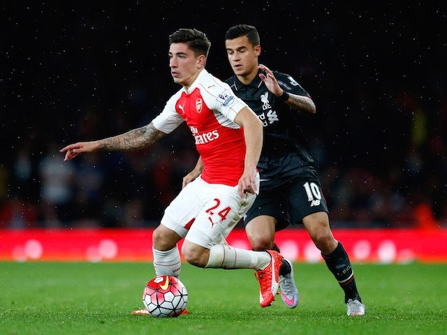Liverpool's Philippe Coutinho chases Hector Bellerin of Arsenal on August 24, 2015