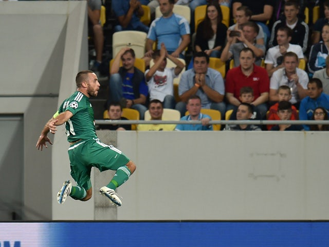 Rapid Wien Steffen Hofmann celebrates his scoring during the UEFA Champions League playoff football match between Shakhtar Donetsk and Rapid Wien at Arena Lviv Stadium in Lviv on August 25, 2015