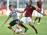 Roma's midfielder from Mali Seydou Keita (R) vies with Juventus' forward from Argentina Paulo Dybala during the Italian Serie A football match AS Roma vs Juventus on August 30, 2015