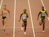 Shelly-Ann Fraser-Pryce of Jamaica beats Dafne Schippers of the Netherlands (L) and Veronica Campbell-Brown of Jamaica to win gold in the Women's 100 metres final during day three of the 15th IAAF World Athletics Championships Beijing 2015 at Beijing Nati