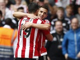 Southampton's Serbian midfielder Dusan Tadic celebrates with Southampton's Italian striker Graziano Pelle (L) after scoring their third goal during the English Premier League football match between Southampton and Norwich City at St Mary's Stadium in Sout