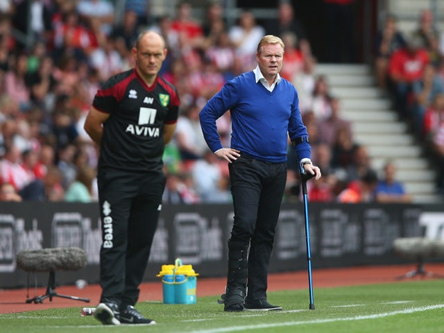 Manager Ronald Koeman of Southampton shouts from the touchline alongside manager Alex Neil of Norwich City during the Barclays Premier League match between Southampton and Norwich City on August 30, 2015