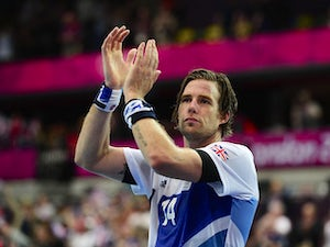 Britain's rightback Steven Larsson applauds after being defeated by Iceland at the end of the men's preliminary Group A handball match Iceland vs Great Britain for the London 2012 Olympics Games on August 6, 201