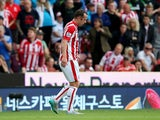 Charlie Adam of Stoke City walks off the pitch after being shown a red card during the Barclays Premier League match between Stoke City and West Bromwich Albion at Britannia Stadium on August 29, 2015