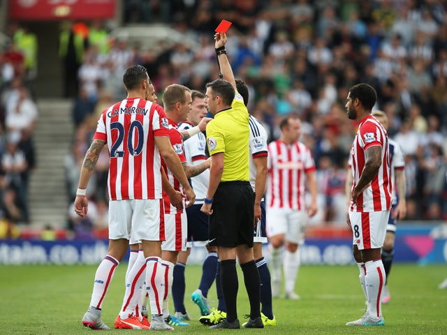 Ibrahim Afellay of Stoke City is shown a red card by referee Michael Oliver during the Barclays Premier League match between Stoke City and West Bromwich Albion at Britannia Stadium on August 29, 2015