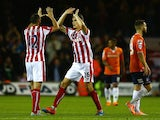 Marc Wilson and Philipp Wollscheid of Stoke City celebrate the goal scored by Jonathan Walters of Stoke City during the Capital One Cup second round match between Luton Town and Stoke City at Kenilworth Road on August 25, 2015