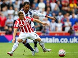 Xherdan Shaqiri of Stoke City and Joleon Lescott of West Bromwich Albion compete for the ball during the Barclays Premier League match between Stoke City and West Bromwich Albion at Britannia Stadium on August 29, 2015