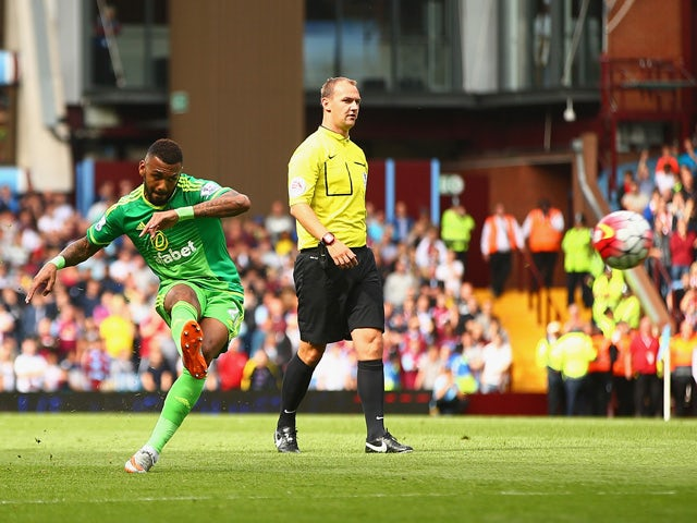 Yann M'Vila of Sunderland scores his team's first goal from a free kick during the Barclays Premier League match between Aston Villa and Sunderland at Villa Park on August 29, 2015