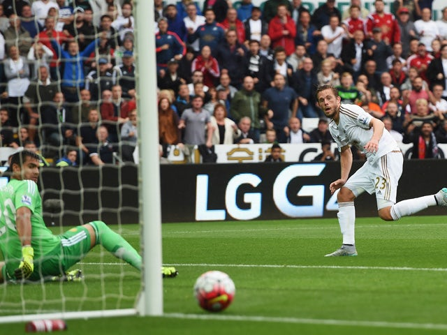 Gylfi Sigurdsson of Swansea City watches his shot go past the post during the Barclays Premier League match between Swansea City and Manchester United at Liberty Stadium on August 30, 2015