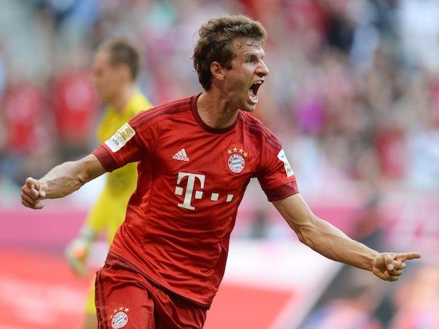 Bayern Munich's striker Thomas Mueller celebrates after scoring the first goal for Munich during the German first division Bundesliga football match Bayern Munich vs Bayer 04 Leverkusen in Munich, southern Germany, on August 29, 2015