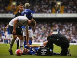 Tom Cleverley of Everton receives a medical treatment during the Barclays Premier League match between Tottenham Hotspur and Everton at White Hart Lane on August 29, 2015