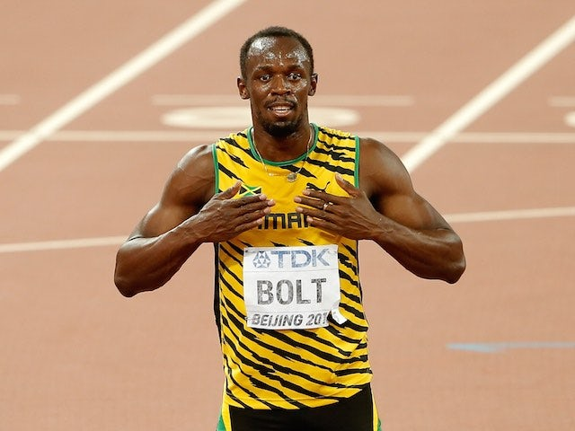 'Big' Usain Bolt celebrates on his knees after winning gold in the men's 200m at the World Championships on August 27, 2015