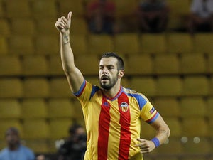 Valencia's forward Alvaro Negredo celebrates after scoring during the UEFA Champions League playoff football match between AS Monaco FC vs Valencia CF, at the Louis II Stadium, in Monaco, on August 25, 2015
