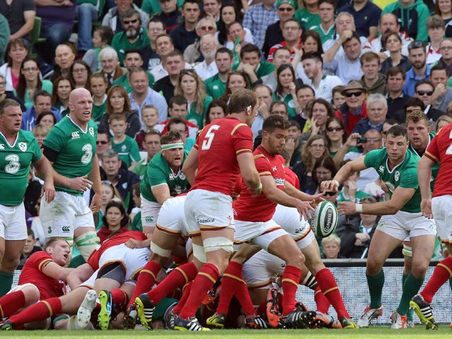 Wales's scrum half Rhys Webb kicks the ball up-field during the 2015 Rugby World Cup warm up match between Ireland and Wales at the Aviva Stadium in Dublin, Ireland on August 29, 2015