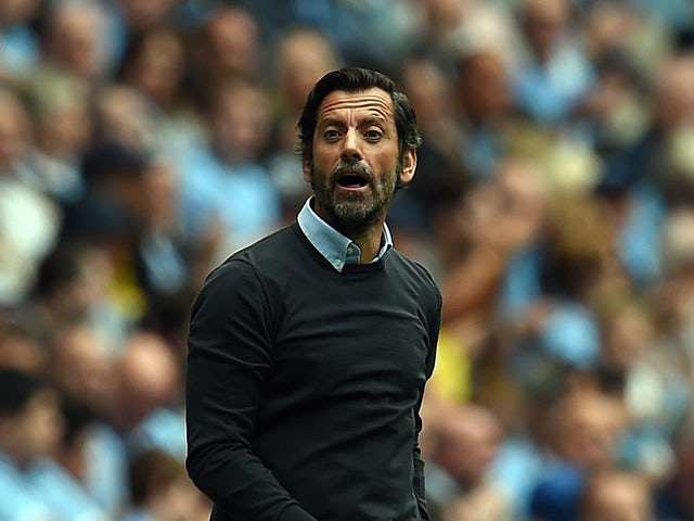 Watford's Spanish manager Quique Sanchez Flores looks on during the English Premier League football match between Manchester City and Watford at The Etihad Stadium in Manchester, north west England on August 29, 2015