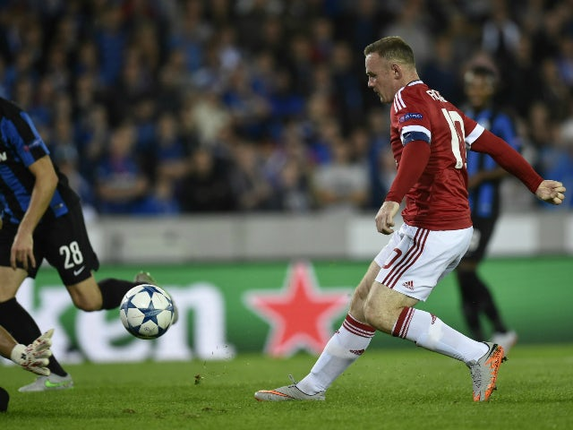 Manchester's Wayne Rooney scores the opening goal during the UEFA Champions League play-off round second leg football match between Club Brugge and Manchester United at Jan Breydel stadium in Bruges, Belgium on August 26, 2015