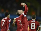 Manchester's Wayne Rooney celebrates after scoring the opening goal during the UEFA Champions League play-off round second leg football match between Club Brugge and Manchester United at Jan Breydel stadium in Bruges, Belgium on August 26