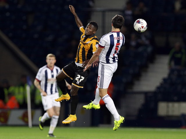 Claudio Yacob (R) of West Bromwich Albion and Enoch Andoh of Port Vale contest a header during the Capital One Cup Second Round match between West Bromwich Albion and Port Vale at The Hawthorns on August 25, 2015