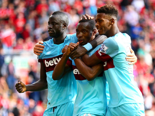 Diafra Sakho of West Ham United celebrates scoring his team's third goal with his team mates Cheikhou Kouyate and Reece Oxford during the Barclays Premier League match between Liverpool and West Ham United at Anfield on August 29, 2015