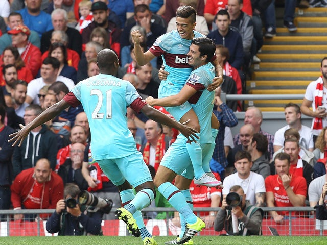 West Ham United's Argentinian midfielder Manuel Lanzani celebrates after scoring his team's first goal during the English Premier League football match between Liverpool and West Ham at the Anfield stadium in Liverpool, north-west England on August 29, 20
