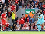 West Ham United's English midfielder Mark Noble receives a red card from referee Kevin Friend for a challenge on Liverpool's English striker Danny Ings (Below L) during the English Premier League football match between Liverpool and West Ham at the Anfiel
