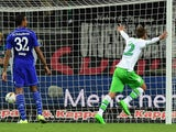 Wolfsburg's Dutch striker Bas Dost celebrates after scoring during the German first division Bundesliga football match VfL Wolfsburg vs FC Schalke 04 in Wolfsburg, northern Germany, on August 28, 2015