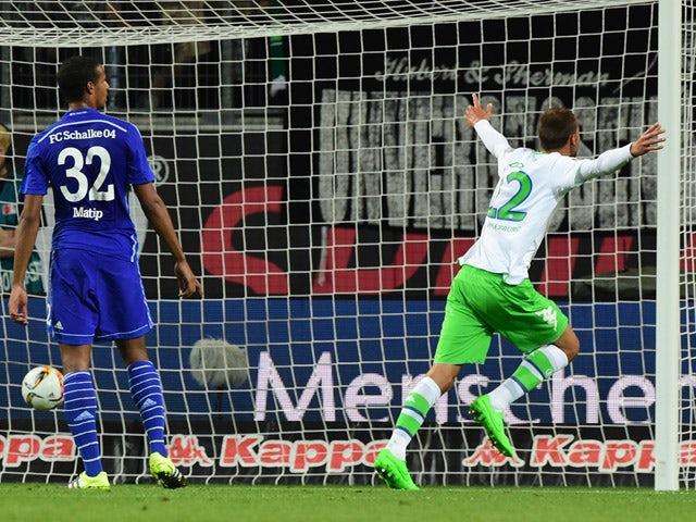 Wolfsburg's Dutch striker Bas Dost celebrates after scoring during the German first division Bundesliga football match VfL Wolfsburg vs FC Schalke 04 in Wolfsburg, northern Germany, on August 28, 2015