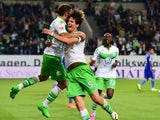 Wolfsburg's Swiss defender Timm Klose celebrates with Wolfsburg's Swiss defender Ricardo Rodriguez after Klose scored the third goal during the German first division Bundesliga football match VfL Wolfsburg vs FC Schalke 04 in Wolfsburg, northern Germany,
