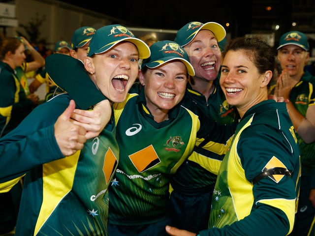 Australia players celebrate their win over England during the 2nd NatWest T20 of the Women's Ashes Series between England and Australia Women at BrightonandHoveJobs.com County Ground on August 28, 2015