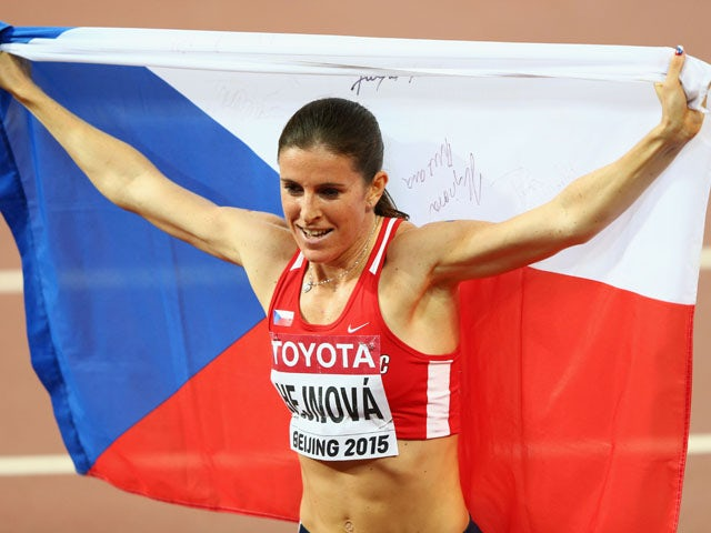 Zuzana Hejnova of the Czech Republic celebrates after winning gold in the Women's 400 metres hurdles final during day five of the 15th IAAF World Athletics Championships Beijing 2015 at Beijing National Stadium on August 26, 2015