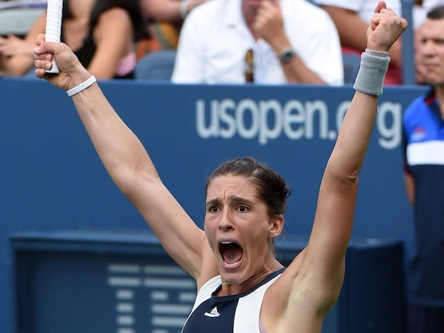 Andrea Petkovic of Germany celebrates match point against Caroline Garcia of France during their 2015 US Open Women's singles round 1 match at the USTA Billie Jean King National Tennis Center September1, 2015 in New York. AFP PHOTO / TIMOTHY A. CLARY