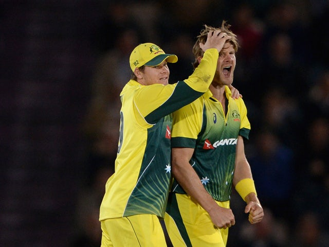 Shane Watson of Australia celebrates with captain Steven Smith after dismissing England captain Eoin Morgan during the 1st Royal London One-Day International match between England and Australia at Ageas Bowl on September 3, 2015