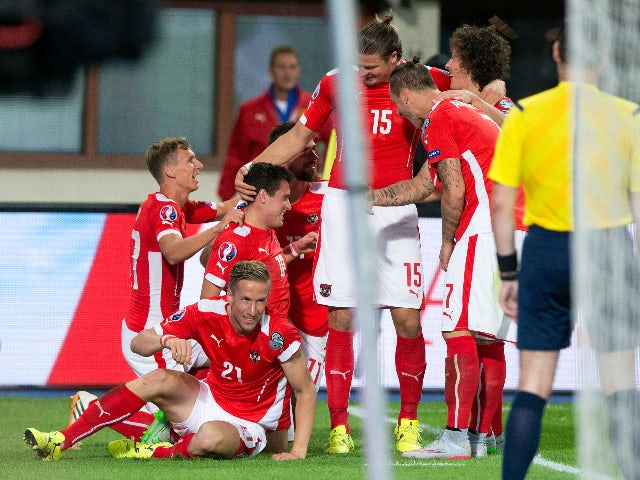 Austria's Zlatko Junuzovic (C) celebrates with team mates after scoring the first goal for Austria during the Euro 2016 qualifying Group G football match between Austria and Moldova in Vienna on September 5, 2015.