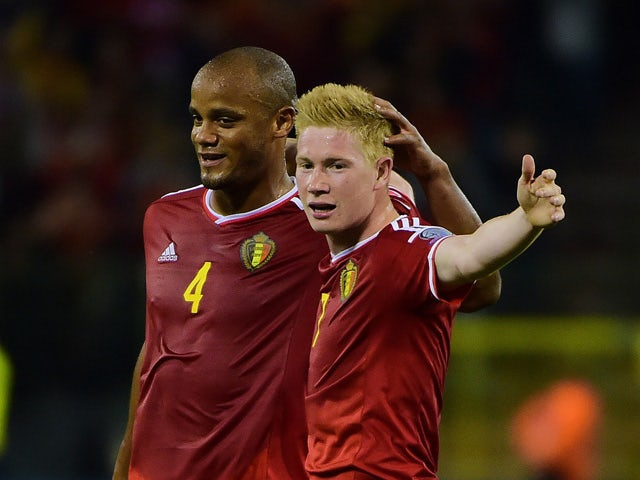 Belgium's Kevin De Bruyne celebrates after scoring with Belgium's Vincent Kompany during the Euro 2016 qualifying match between Belgium and Bosnia and Herzegovina at the King Baudouin Stadium in Brussels, on September 3, 2015