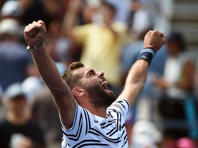 France's Benoit Paire celebrates defeating Japan's Kei Nishikori during their Mens Singles round 1 match of the US Open at USTA Billie Jean King National Tennis Center in New York on August 31, 2015
