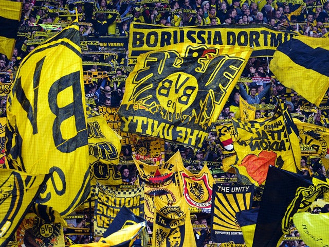 Dortmund's fans cheer their team during the German First division Bundesliga football match Borussia Dortmund vs Hannover 96 on October 25, 2014