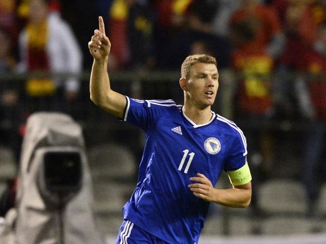 Bosnia and Herzegovina's Edin Dzeko celebrates after scoring during the Euro 2016 qualifying match between Belgium and Bosnia and Herzegovina at the King Baudouin Stadium in Brussels, on September 3, 2015