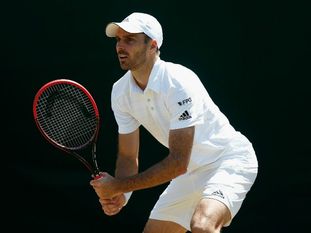 Colin Fleming of Great Britain in action in his Gentlemen's Second Round match with Eric Butorac of the United States against Vasek Pospisil of Canada and Jack Sock of the United States during day five of the Wimbledon Lawn Tennis Championships at the