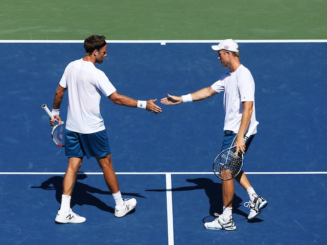 Dominic Inglot of Great Britain and Robert Lindstedt of Sweden play against Tommy Haas of Germany and Radek Stepanek of the Czech Republic during their Men's Doubles Third Round match on Day Seven of the 2015 US Open.