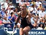 Dominika Cibulkova of Slovakia celebrates match point against Ana Ivanovic of Serbia during their Women's singles 2015 US Open round 1 match at the USTA Billie Jean King National Tennis Center August 31, 2015