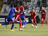 Belgium's Eden Hazard (2R) dribbles the ball towards the Cypriot defence as his teammate Radja Nainggolan (R) watches on during their EURO 2016 qualifying football match between Cyprus and Belgium at the Neo GSP stadium in the Cypriot capital, Nicosia, on