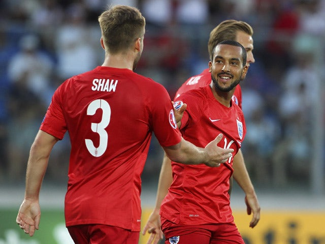 Theo Walcott (R) of England celebrates his goal with his team-mate Luke Shaw (L) during the UEFA EURO 2016 Qualifier between San Marino and England at Stadio Olimpico on September 5, 2015