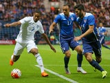 Jordan Ibe of England takes on Jerome Kiesewetter of USA, centre, and Eric Miller of USA, right, during the International friendly match between England U21 and USA U23 at Deepdale on September 3, 2015