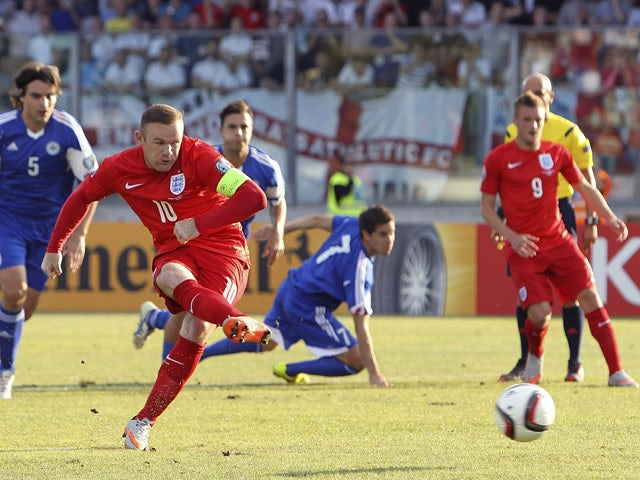 Wayne Rooney of England scores the opening goal from the penalty spot during the UEFA EURO 2016 Qualifier between San Marino and England at Stadio Olimpico on September 5, 2015