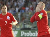 Wayne Rooney of England celebrates after scoring the opening goal during the UEFA EURO 2016 Qualifier between San Marino and England at Stadio Olimpico on September 5, 2015