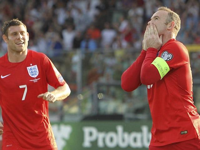 Wayne Rooney of England celebrates after scoring the opening goal during the UEFA EURO 2016 Qualifier between San Marino and England at Stadio Olimpico on September 5, 2015