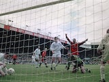 Manchester United players celebrate an own goal by Leeds United keeper Nigel Martyn (kneeling, right), during an English Premier League match at Elland Road, Leeds, 7th September 1996