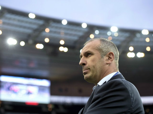 France's head coach Philippe Saint-Andre (R) looks on before the rugby union test match between France and Scotland at the Stade de France in Saint-Denis, near Paris, on August 5, 2015.