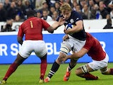 Scotland's lock Jonny Gray (C) vies for the ball with France's prop Eddy Ben Arous (L) during the rugby union test match between France and Scotland at the Stade de France in Saint-Denis, north of Paris